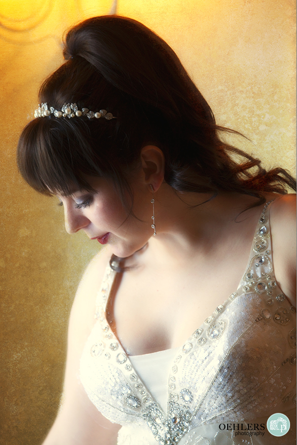 Beautiful, romantic portrait of a bride looking down.