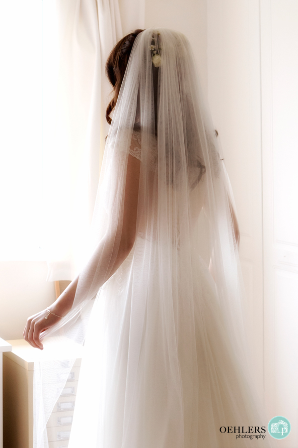 Lovely, soft photograph of the bride in her wedding dress.