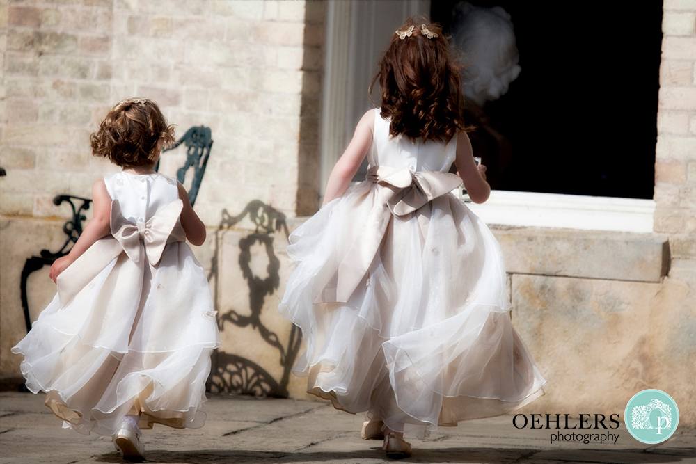 flower girls running away from the camera