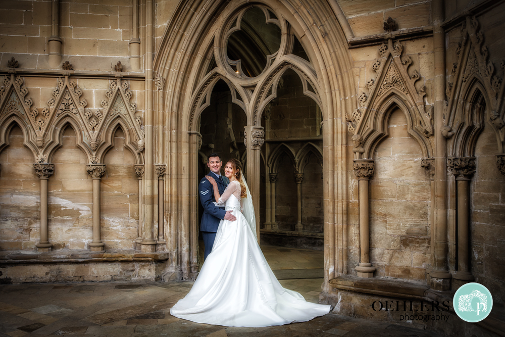 bride and groom posing at Southwell Minster