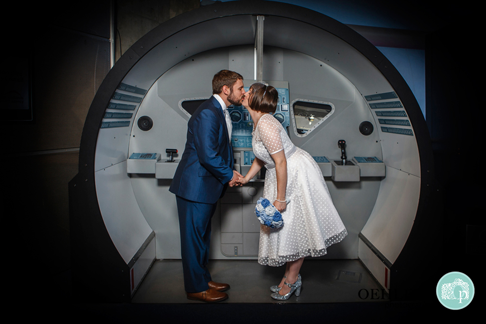 Bride and Groom stealing a kiss in the Space Centre