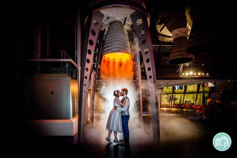 Bride and Groom under a rocket in the Space Centre