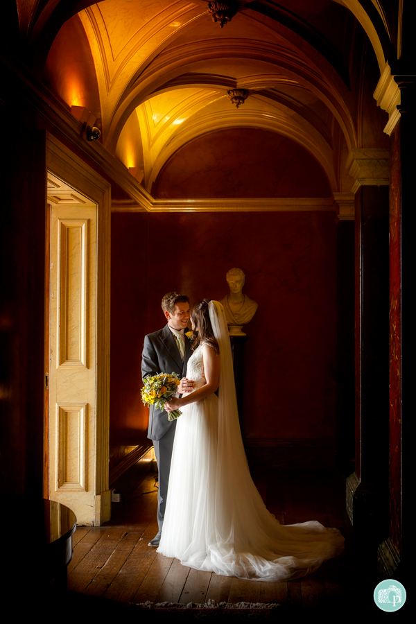 bride and groom in front of a doorway