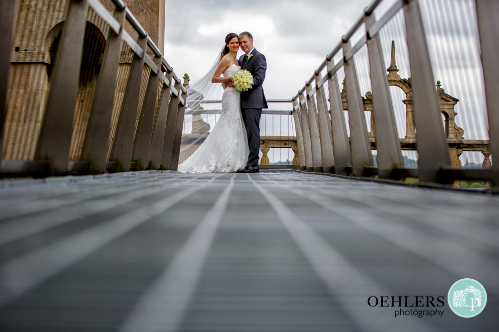 Low perspective of Bride and Groom at the end of leading lines
