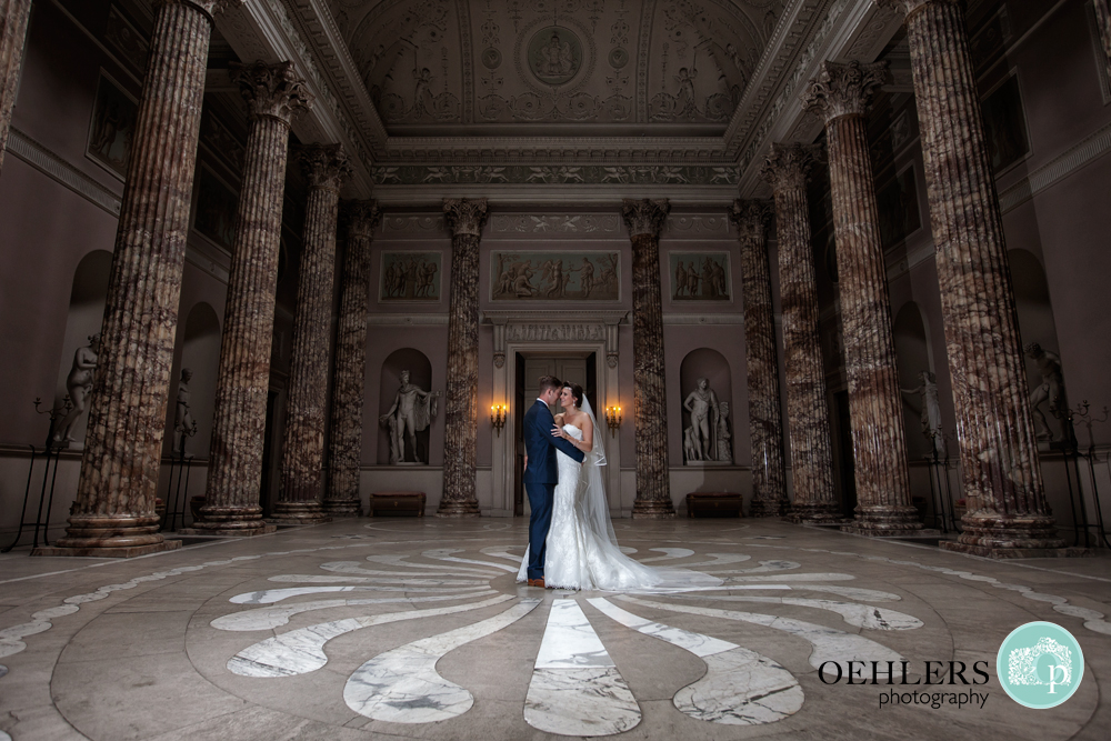 Bride and Groom dancing in the marble hall of Kedleston Hall