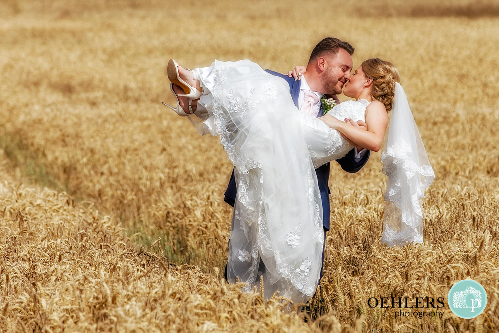 Groom swept Bride up in a corn field