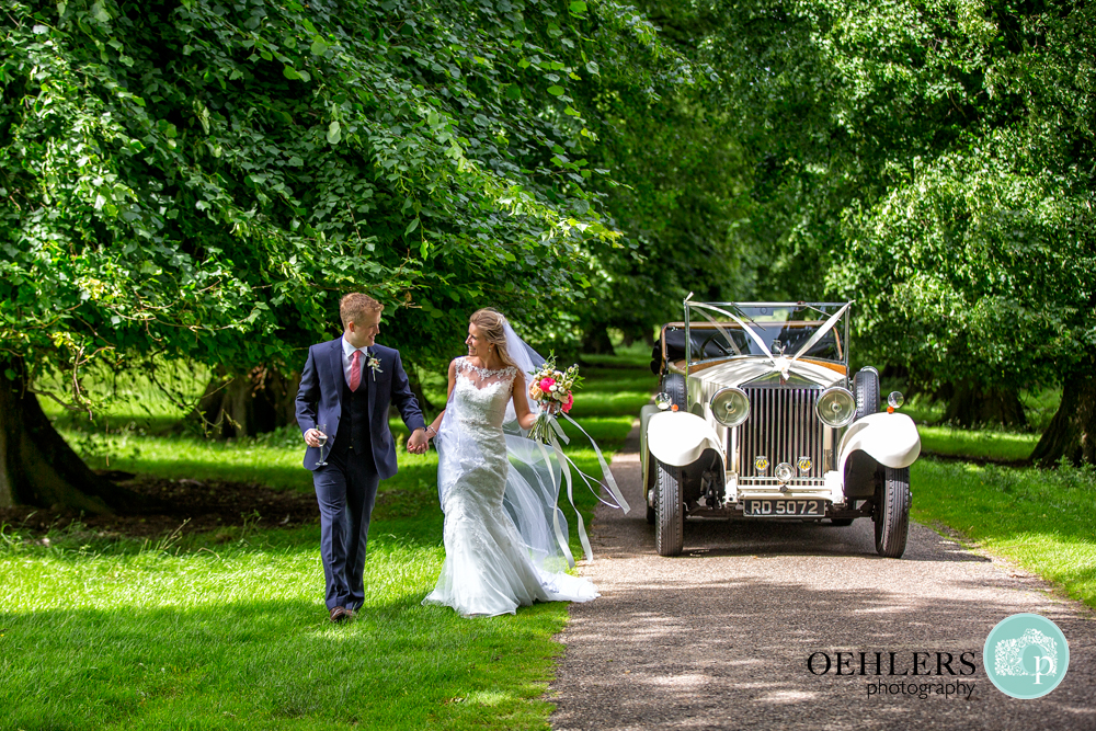 Bride and Groom stretching their legs at Calke Abbey