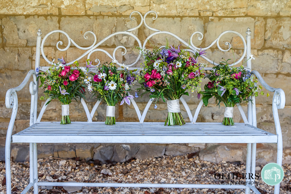 wedding bouquets on a bench