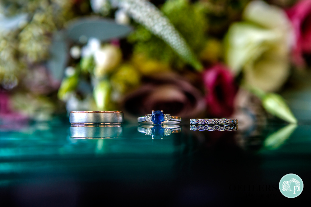 Wedding rings and sapphire engagement ring in the middle