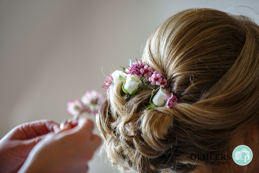 Lovely delicate flowers in the bun of the bridesmaids hair