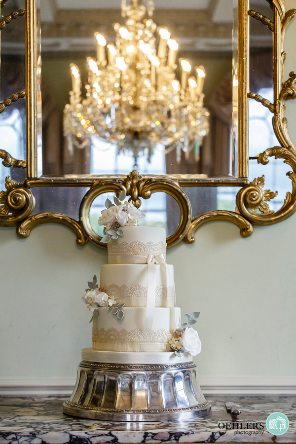 wedding cake in front of a mirror