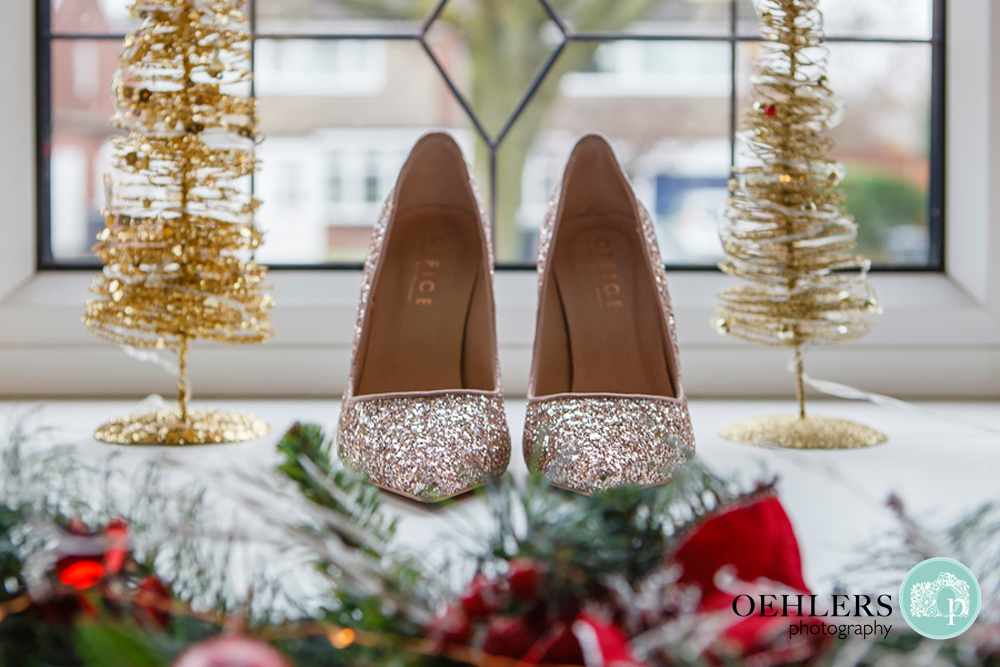 glittery wedding shoes amidst christmas decorations