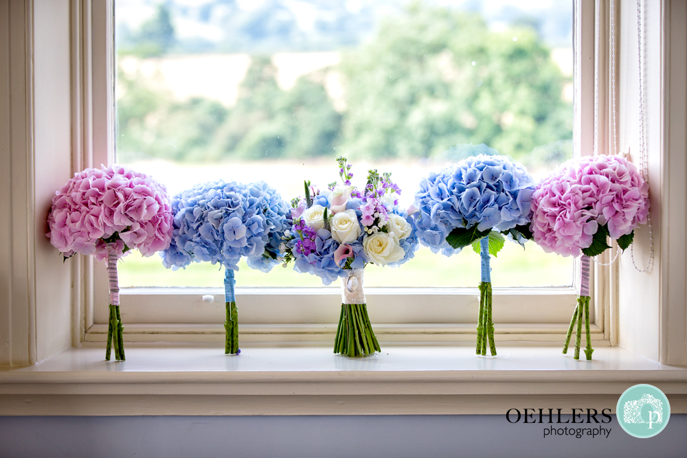 bride bouquet and bridesmaids bouquets on a window sill