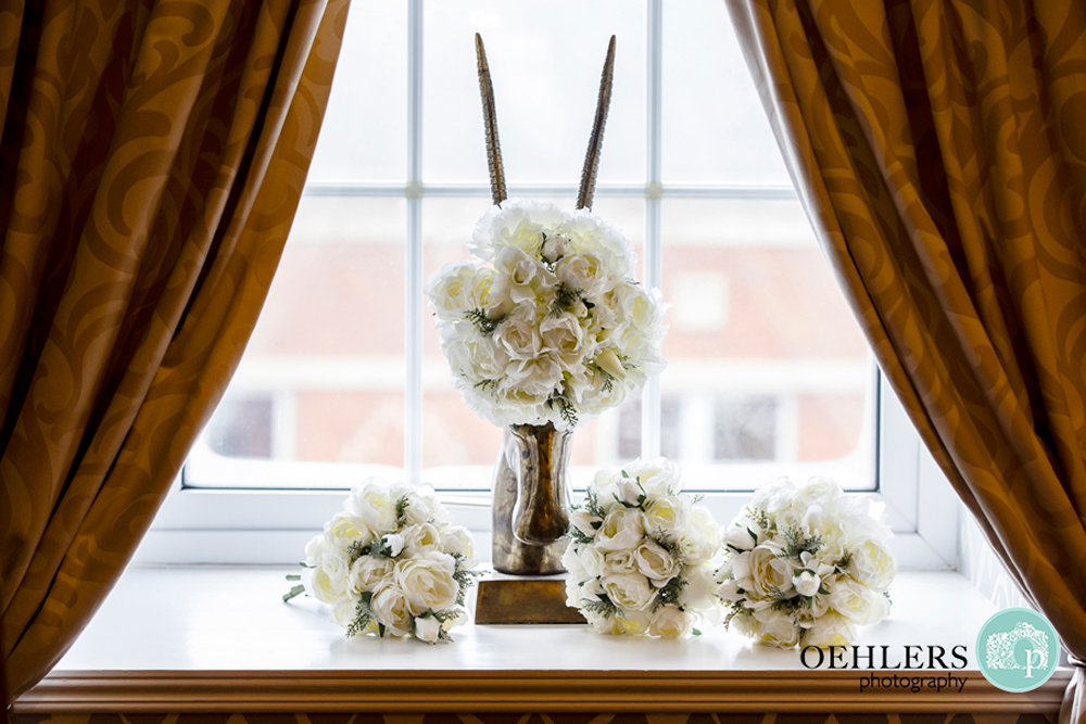 bridal flowers on a window sill with bridal bouquet on antelopes head