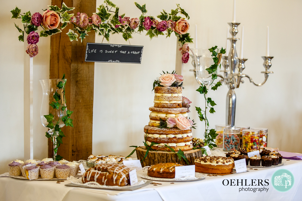 table full of delicious cakes including the wedding cake