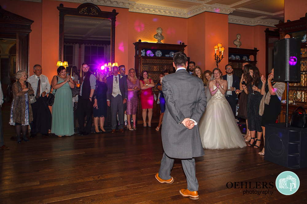 Groom doing a jig in front of his Bride