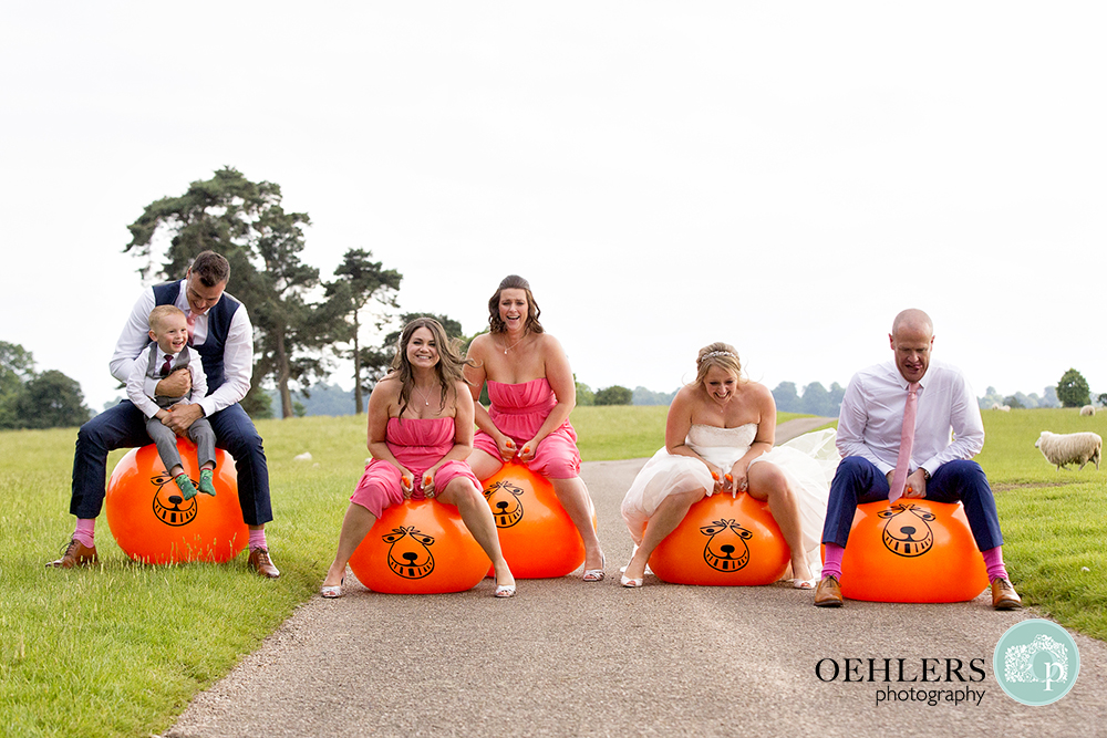 Bride and Groom and guests on space hoppers having a race
