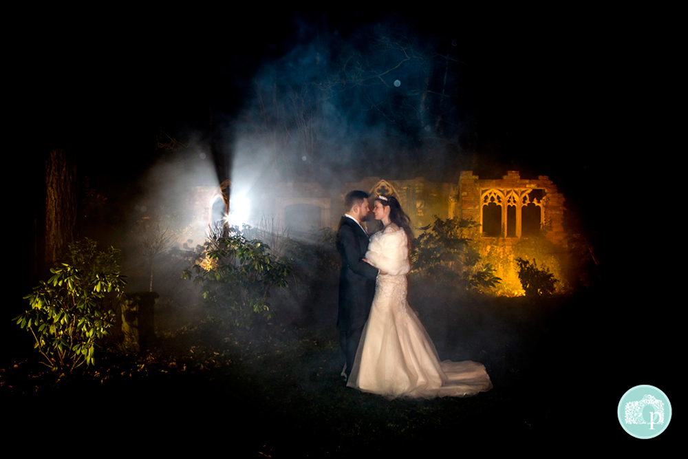 twilight shot of Bride and Groom in the ruins with smokey background