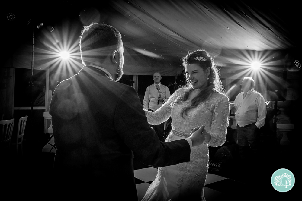 Black and White shot of Bride and Groom enjoying their dance