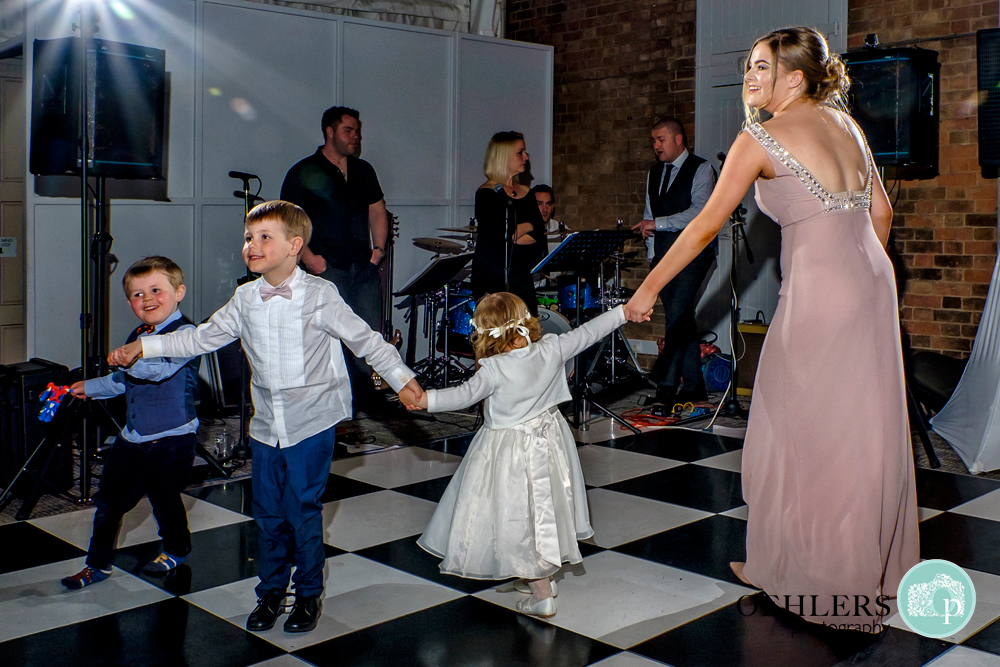 Bridesmaids dancing with the flowergirl