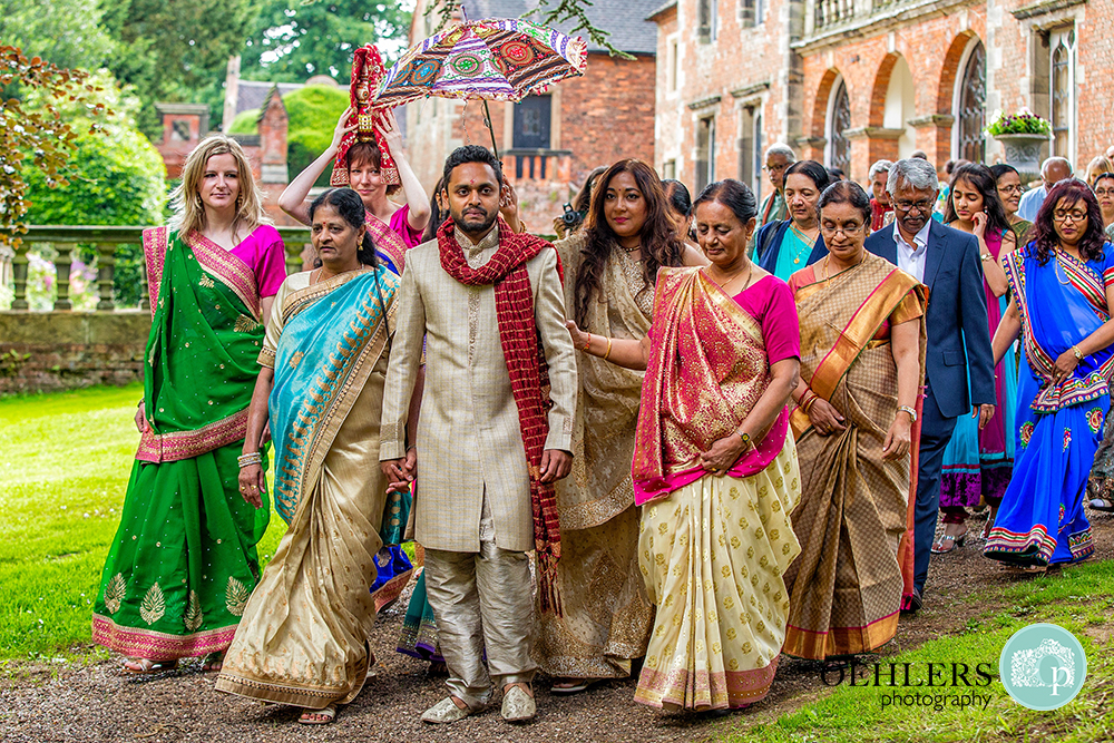 Indian Groom being led to the ceremony by guests