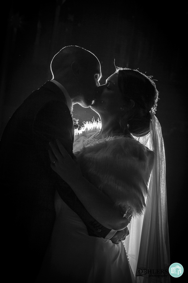 Backlit shot of Bride and Groom in the evening