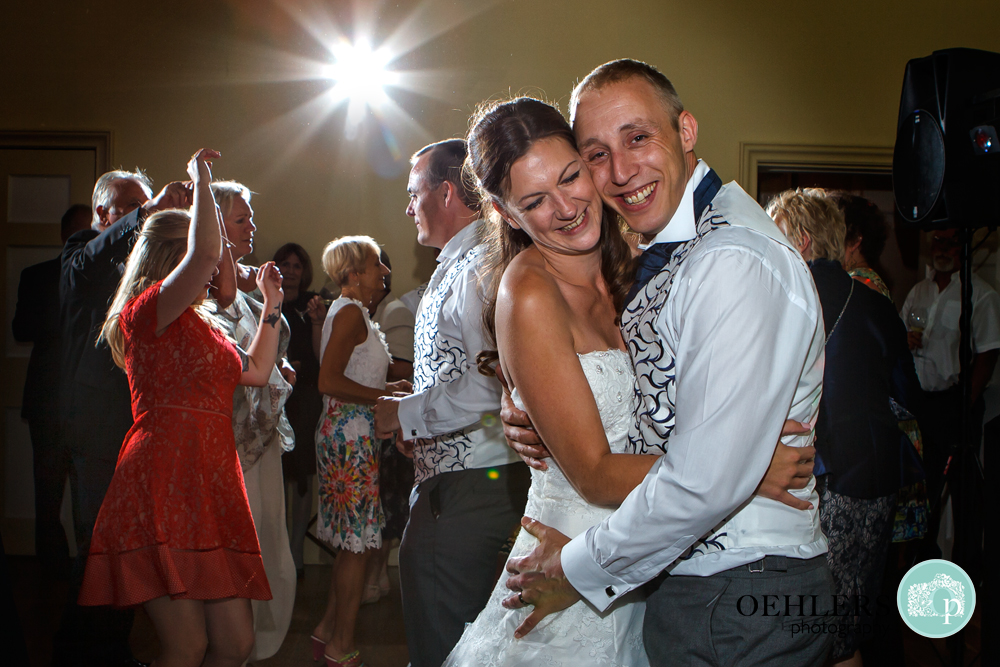 Bride and Groom snuggle together for their dance
