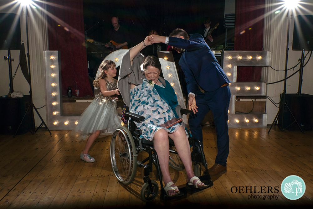 On the dance floor dancing with mum in a wheelchair