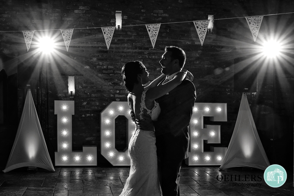First Dance with Love sign and starbursts in the background