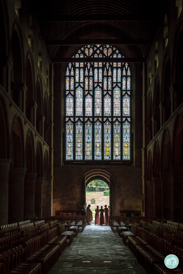 bridesmaids in doorway of Southwell Minster