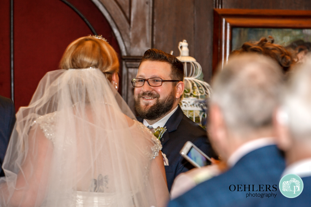 groom looking at his bride at Thrumpton Hall