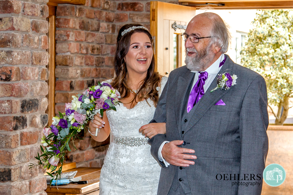smiling bride and dad