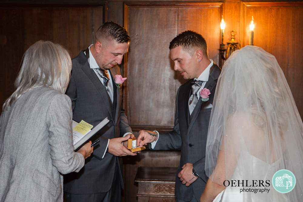 bestman giving ring to groom