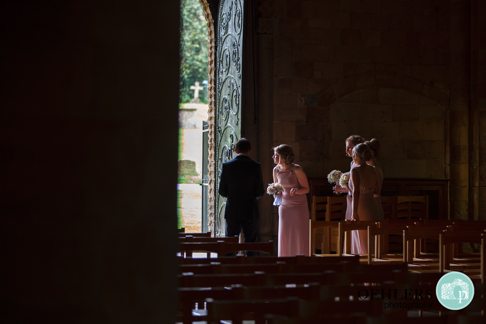 bridesmaid wait for their bride at Southwell Minsters doorway