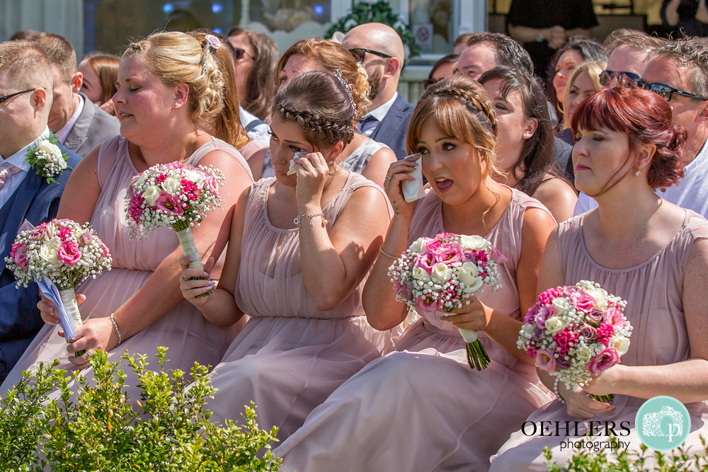 bridesmaids crying emotionally