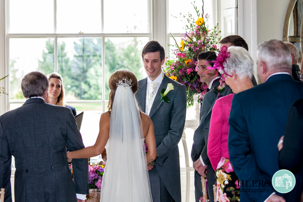 emotional groom as bride arrives beside him
