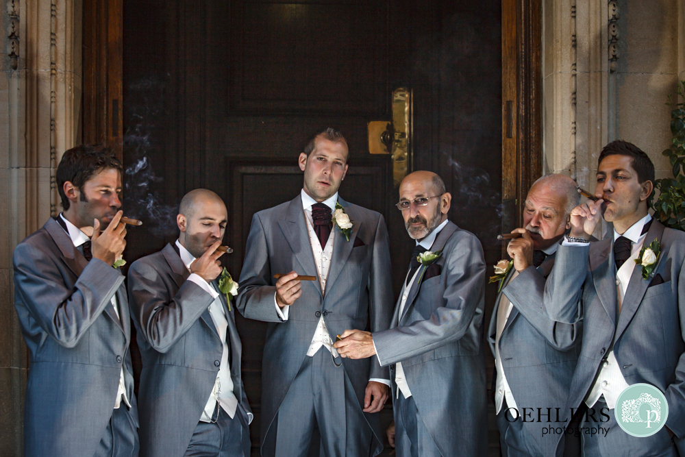 Groomsmen enjoying cigars