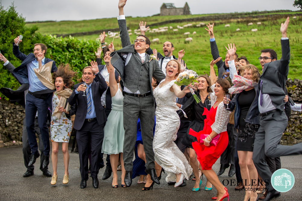 Group Shot of Bridae and Groom's friends jumping for joy.