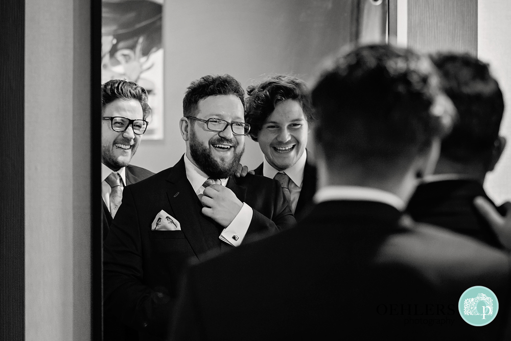 groomsmen looking in a mirror