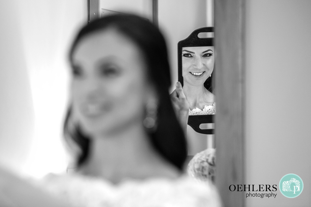 bride's reflection in a mirror
