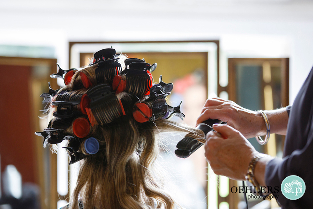 Bride with curlers on her hair