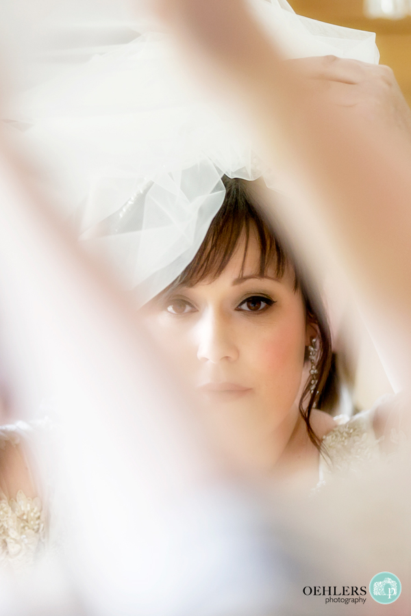 photograph of bride in the mirror