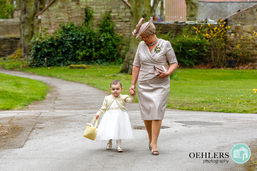 grandma walking her granddaughter to the church