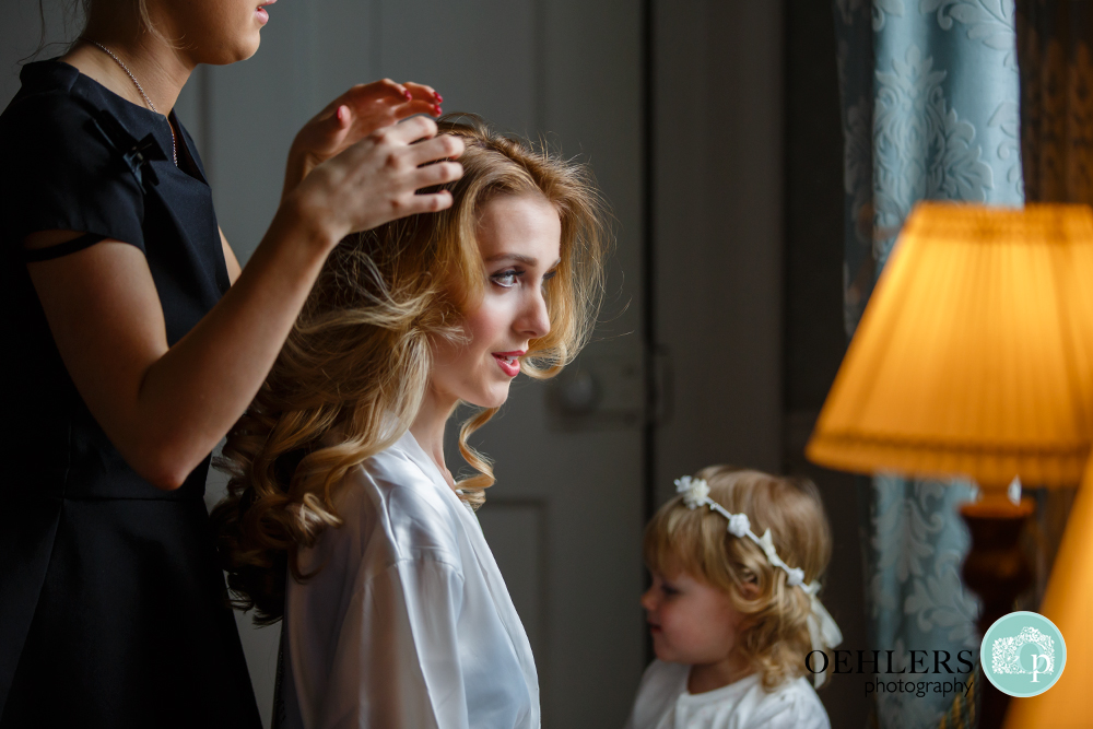 bride getting having her hair styled