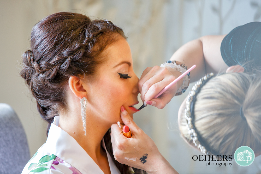 make up being put on a bride