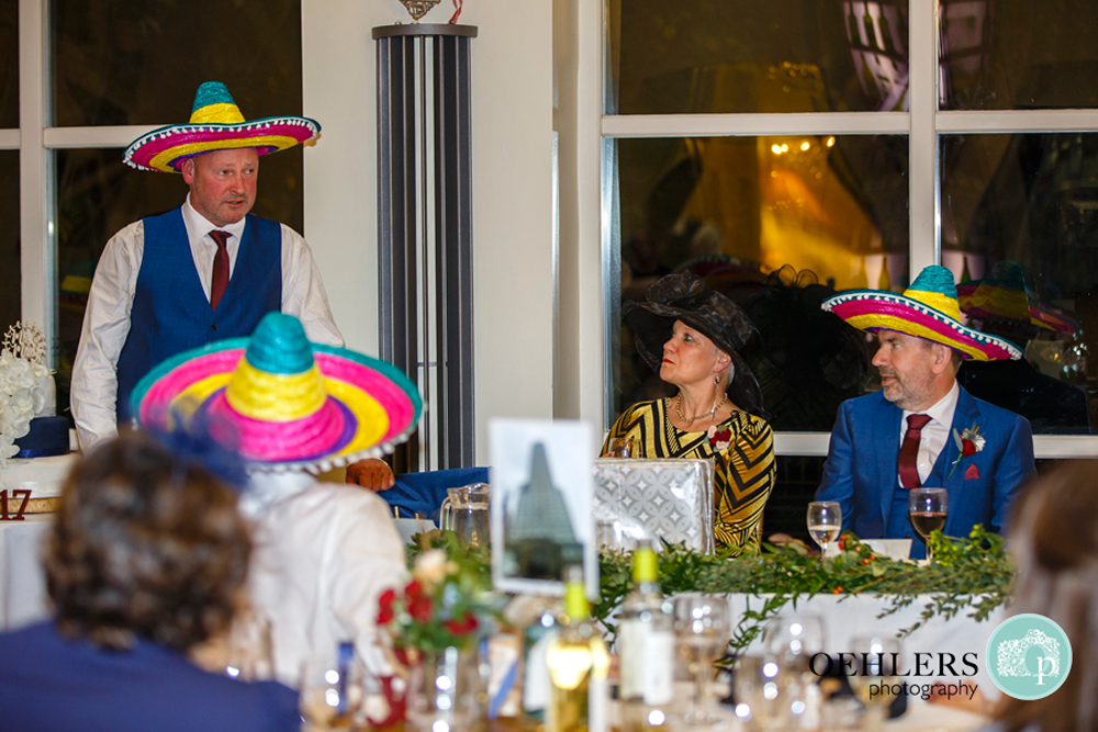 Best man wearing a sombrero whilst delivering a speech