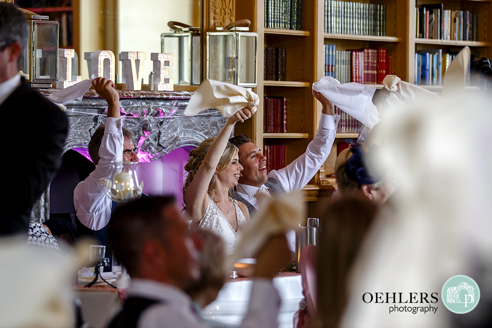 Bride and Groom waving their serviettes