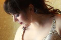 Beautiful, romantic portrait of a bride looking down.