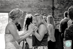 guest overjoyed at seeing bride's ring