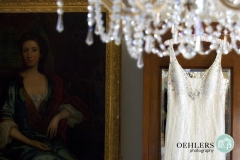 wedding dress hanging from a chandelier